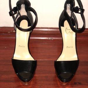 Black platform Louboutin shoes
